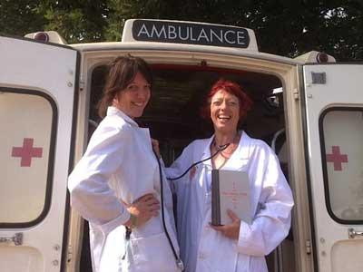 Ella and Susan dispensing bibliotherapy wisdom from a vintage ambulance at the Latitude Festival, UK.