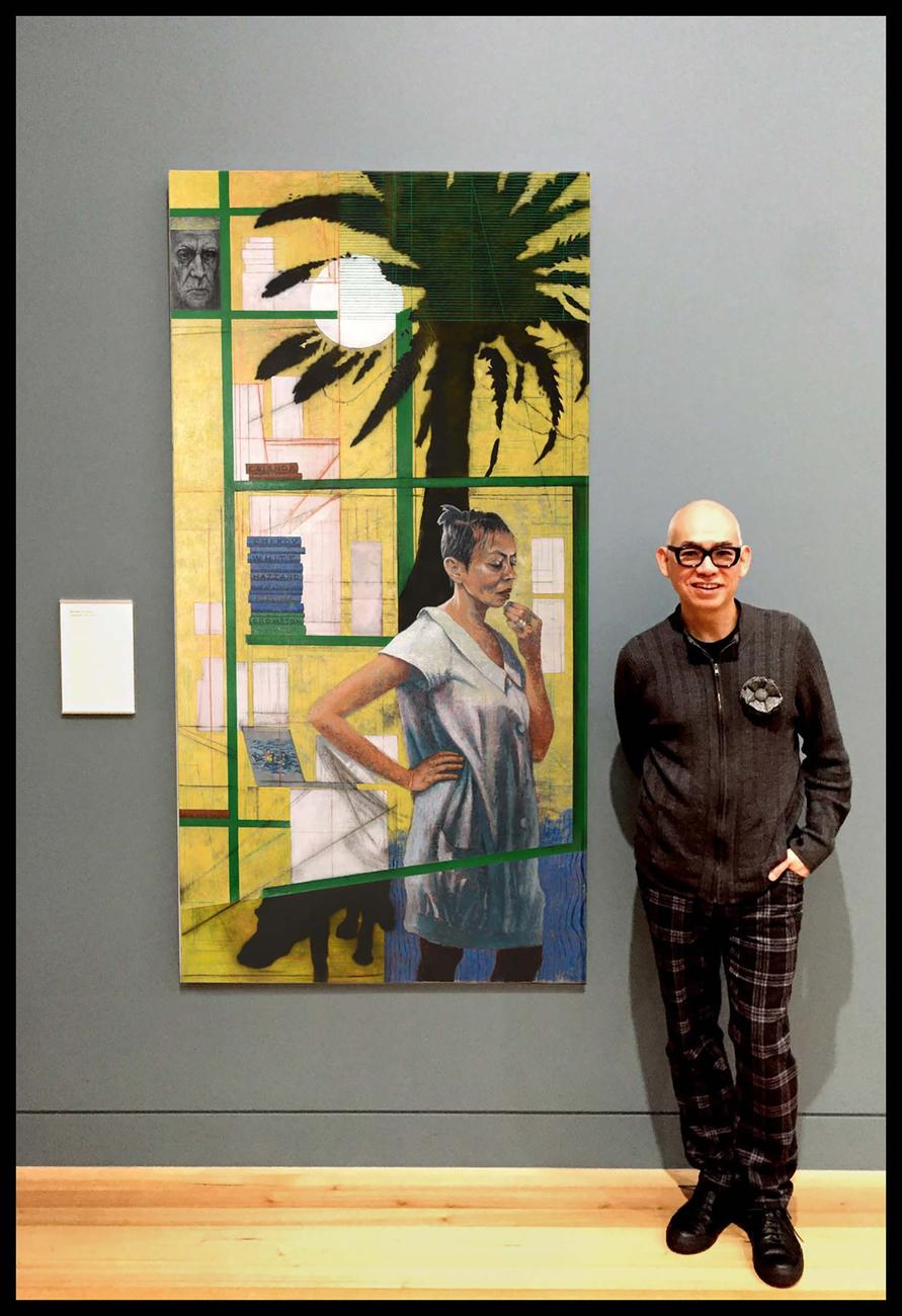 Chong standing beside his portrait of Michelle de Kretser at the National Portrait Gallery