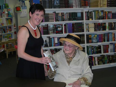Danielle Wood presents Marjorie Bligh with a copy of *Housewife Superstar*